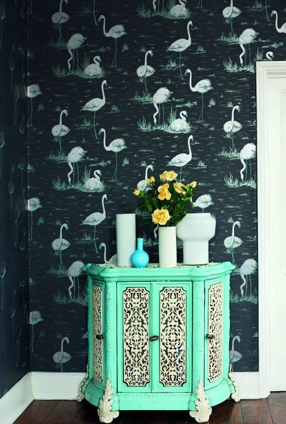 Dark blue wallpaper and light turquoise table.