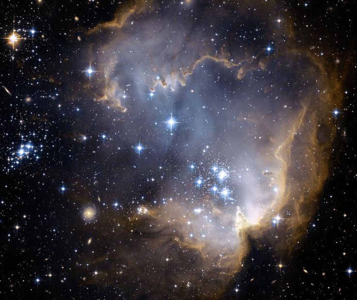 Near the outskirts of the Small Magellanic Cloud, a satellite galaxy some 200 thousand light-years distant, lies 5 million year young star cluster NGC 602.