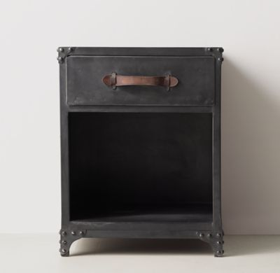 RH TEEN's Calvin Nightstand :Our collection wears its sturdy steel construction on its sleeve, featuring exposed rivets and corner brackets. A stout silhouette and distressed leather pulls lend it the heft and grit of a vintage industrial find.