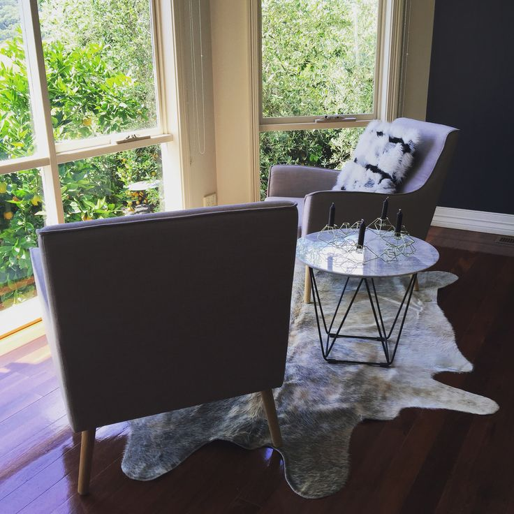 Great little space to gaze out the window creating at one of my clients homes.  Gorgeous hide, marble top side table & beautiful grey relaxing chairs.