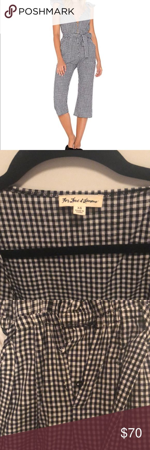 For Love and Lemons Sunny Gingham Romper Black and white checkered jumpsuit as pictured. Size XS worn very minimally but given the thinner fabric 1 bottom button missing-shown in pics. Easily replaced with plain black or white button since it's the bottom one that can't really be seen. Great condition, lightweight and flattering For Love And Lemons Other