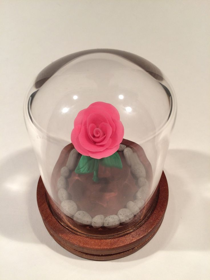 Beauty and the Beast Rose, Enchanted Rose, Bright Pink rose in a glass dome, Glow in the dark, Holiday Sale!. Gorgeous Bright Pink Rose in a Glass dome. Handcrafted from polymer Clay, these amazing Fairy Tale Roses glow in the dark. The roses are individually created, from the color to each petal, the stem and each leaf. Every faux pebble and the dirt they rest in, all created by hand. Each rose is unique, an individual creation. A wonderful and unique idea for Mothers Day, Valentine's…