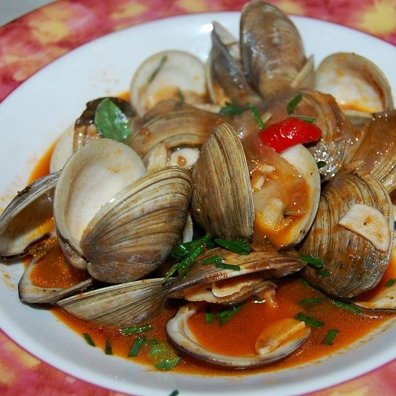 Pressure cooker spicy steamed clams. Clams with dry white wine,spices and vegetables cooked in pressure cooker. Serve with delicious pressure cooker spicy steamed clams with dry white wine,if desired.