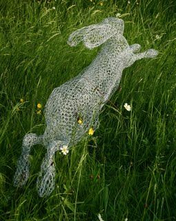Wire sculpture of Christine Moss. Haring Through the Meadow.