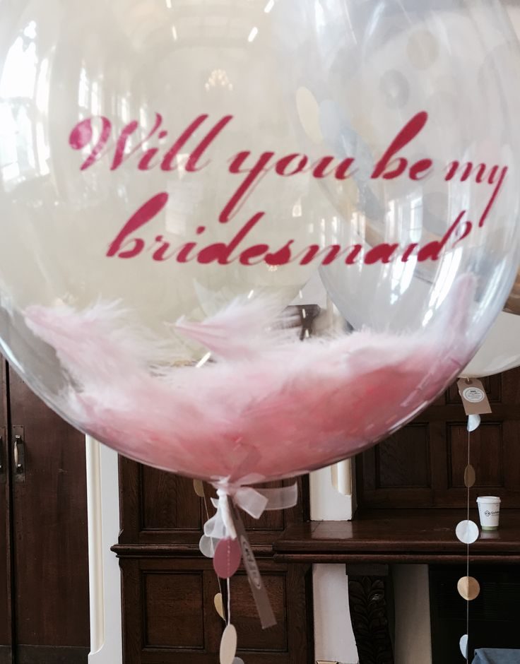 A pretty pink feathery way to ask your BFF to be your bridesmaid