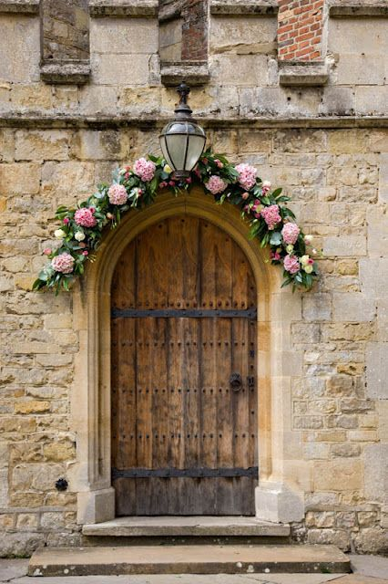 Floral flower garland arch above doorway church