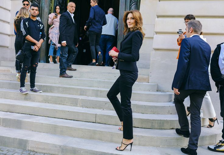 Carla Bruni in suit outfit during the Paris Fashion Week.