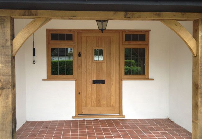 european oak door...Framed ledged door with vision panel and frame with two top opening windows. Visit jonathanelwellinteriors.co.uk