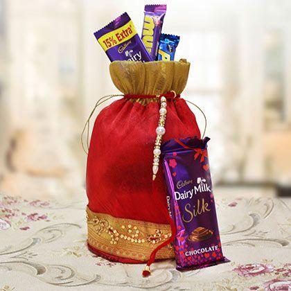 Get Potli of Gorgeous #rakhiwithChocolates http://rakhi.giftalove.com/rakhi-with-chocolates-25.html #Giftaloverakhi