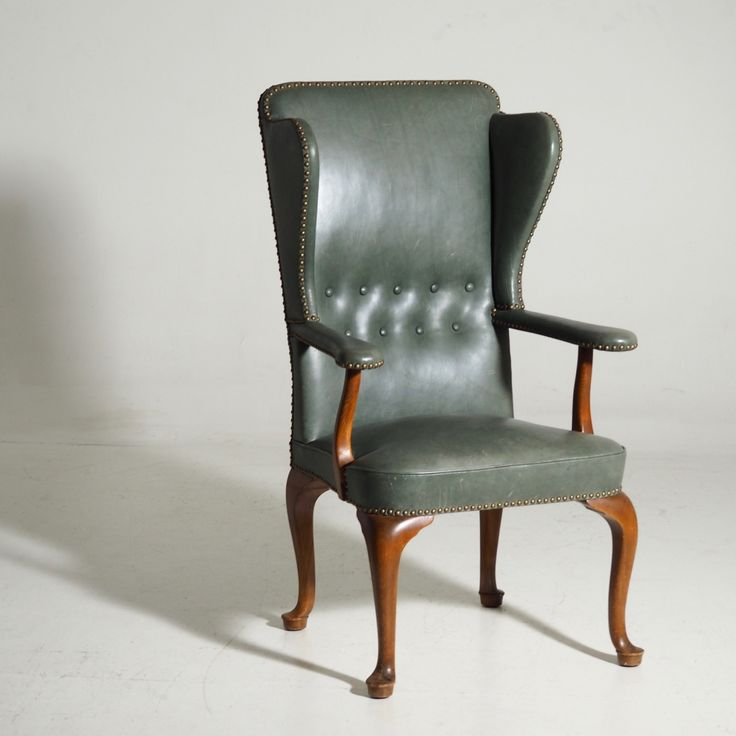 Ref No. 13177-2A  Rare  wingback chair, attributed to Frits Henningsen. Upholstered with green leather and brass nails.
