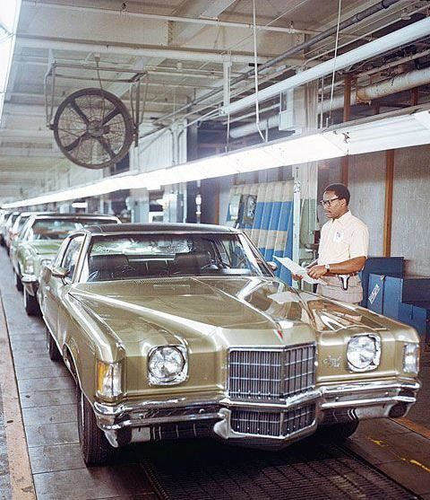 1972 Pontiac Grand Prix. My dad had the same gold with black tonua top, 400 ci, Turbo 400 tranny, 12 bolt posi equipped car when I was growing up.