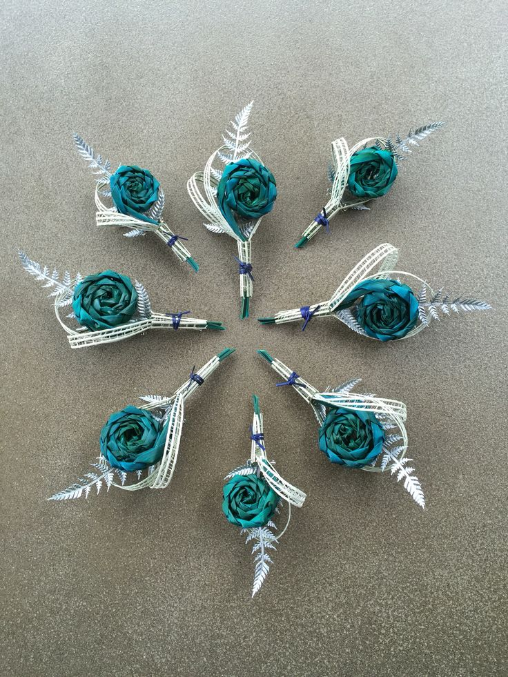 Turquoise Koru buttonholes with silver fern. www.flaxation.co.nz