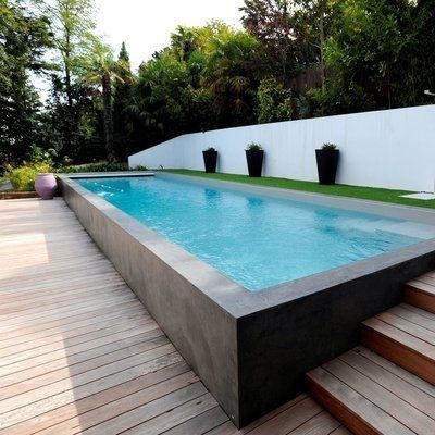 Above ground pool with Bluestone cladding meeting a timber deck