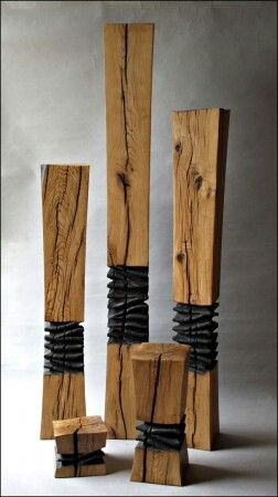 Wood Sculpture Inspiration- add spikes (skewers/toothpicks) around the edge...or in the middle as the anomaly...using natural wood for the rest