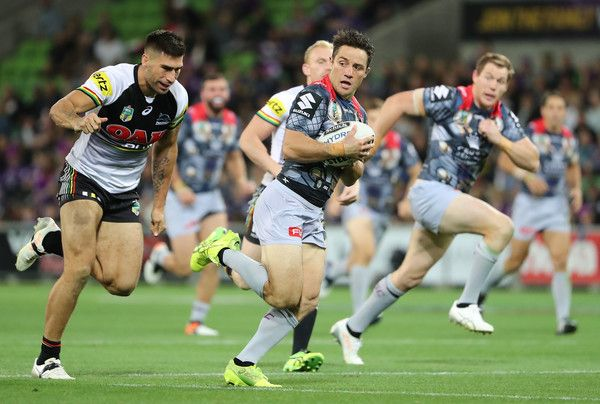 Cooper Cronk Photos Photos - Cooper Cronk of the Melbourne Storm runs away to score a try during the round five NRL match between the Melbourne Storm and the Penrith Panthers at AAMI Park on April 1, 2017 in Melbourne, Australia. - NRL Rd 5 - Storm v Panthers