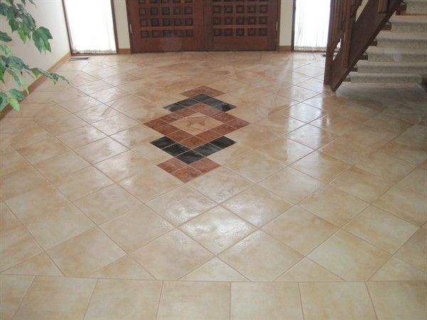 amazing foyer tile floor designs custom tile and hardwood give this