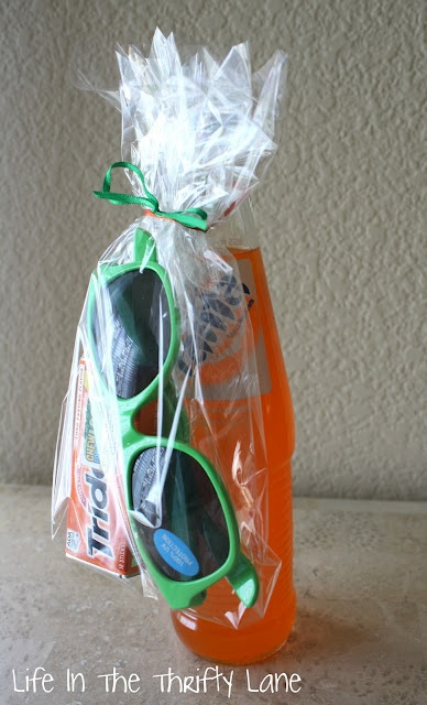 Teen boy party favor: glass bottle of pop, sun glasses, and gum, or the bottle could be sunscreen for a swim- or outdoor-themed party & it could be wrapped in a towel.