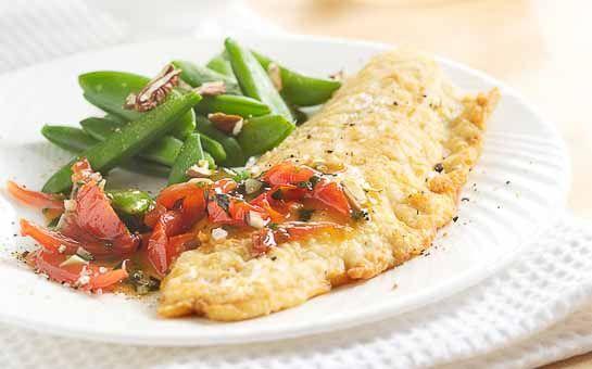 Gebakken zeebaarsfilet met tomaat, dit recept is een prachtig en makkelijk te maken visgerecht, verse zeebaars is heerlijk om te bakken en smaakt erg lekker