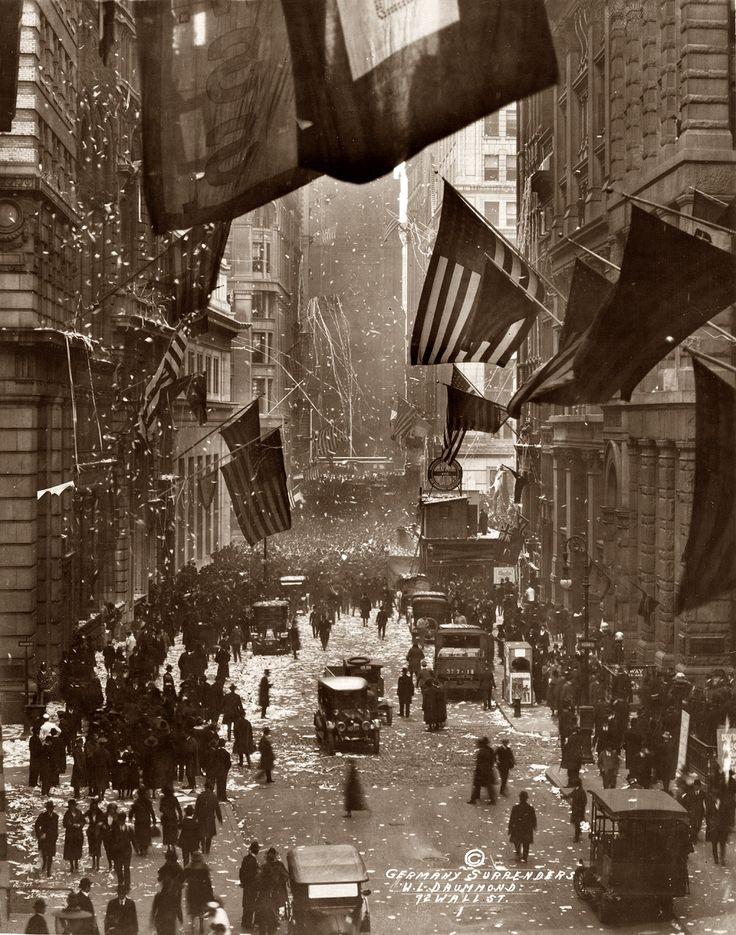 """What we call """"Veterans Day"""" today was originally """"Armistice Day,"""" marking the day WWI ended. In this photo, Americans celebrate news of German surrender on Wall Street, November 1918."""