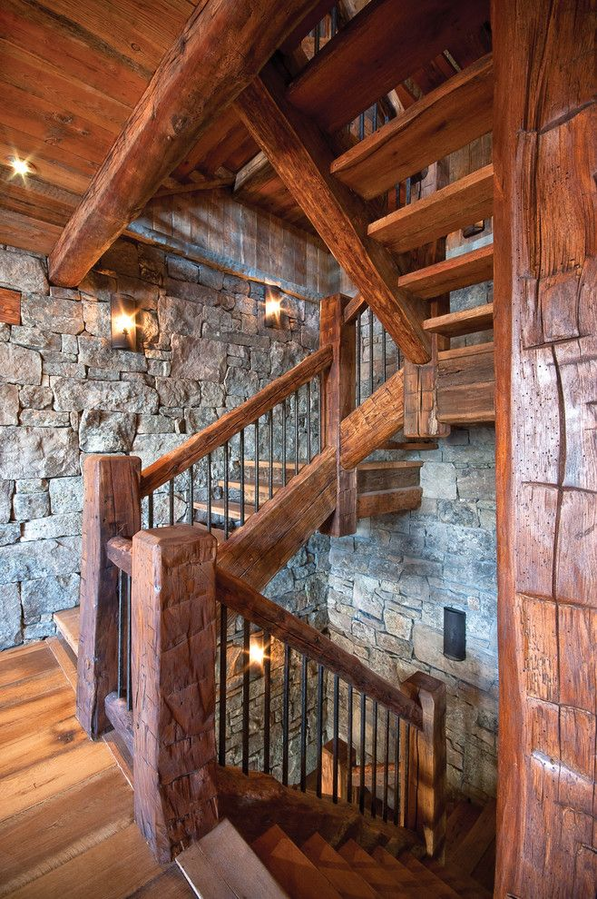 Exquisite Rough Hewn home renovations Rustic Staircase Other Metro home loans cabin hardwood floor landing metal banister open risers rough hewn wood sconce stone wall weathered wood wood handrail wood tread - Decorcology.com