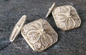 Wednesday's Weekly Feature: Cufflinks   They feature a floral motif that incorporates detailed filigree swirls within each petal. The corners of the square design have been rounded softening the appearance and adding an additional unique flair. Worked entirely in Sterling silver these cufflinks are set to become a family heirloom – why not start the tradition now?  Square = 18mm x 18mm Price: €120.00