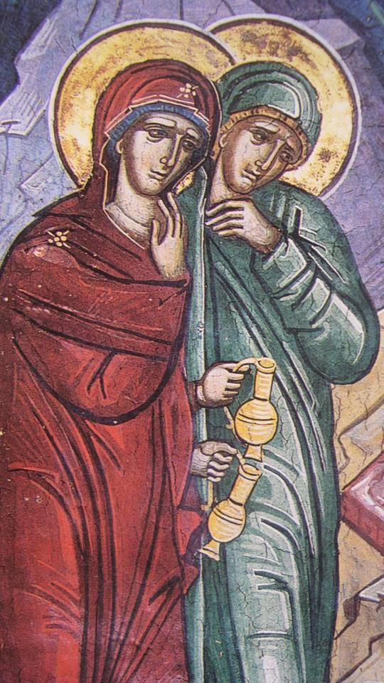 Mary Magdalene (in green) & Mary The Mother of God (in red), with vessels of myrrh, approach the Tomb.