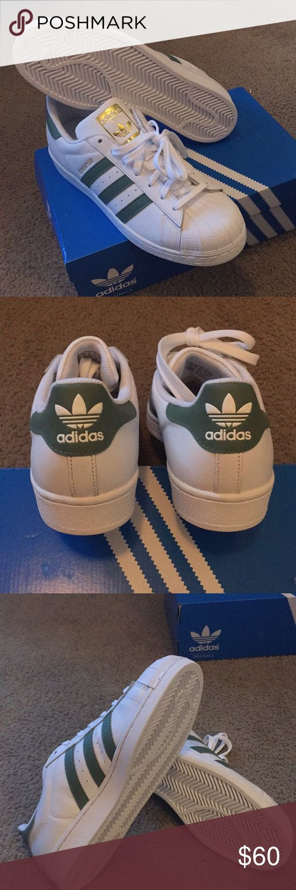 ADIDAS SUPERSTAR SHOES MENS ADIDAS SUPERSTAR SHOES    FTWWHT/ TRAGRN/ GOLDMT/ FTWBLA/ VERTRA/ CRMETA                  NEVER NEEN WORN, comes with box 🎁. (Runs half a size big in size) adidas Shoes Athletic Shoes