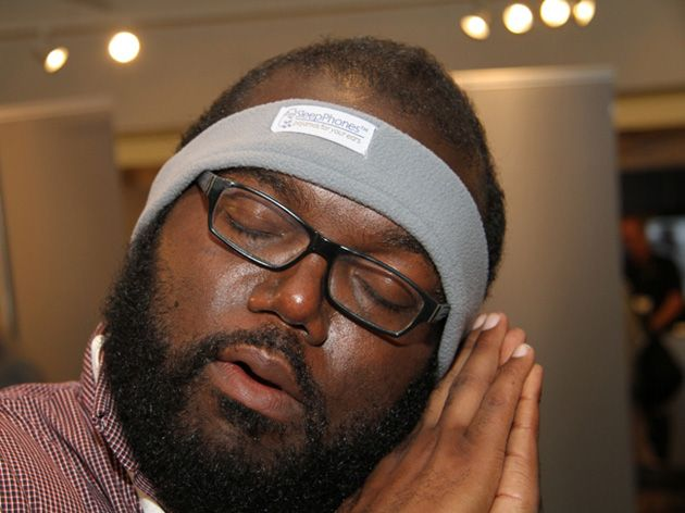 Sleephones - A padded headband with built-in headphones built so your comfortably rest your head against a pillow.