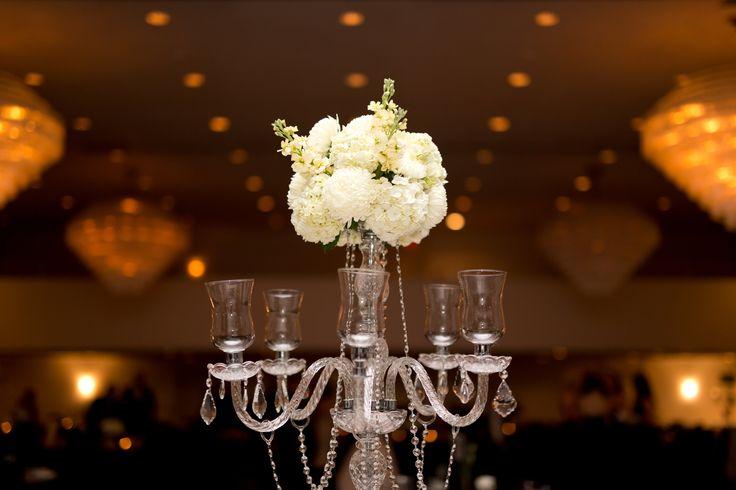 White Flowers Candelabra Centerpiece Flowers: @facheflorals || Photo: @amarie_photo ||