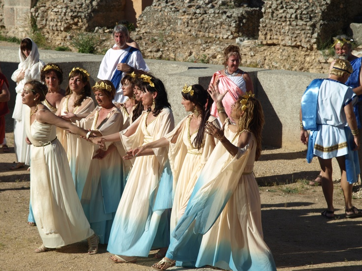 con toga blanca, detrás de las ninfas, se encuentra Reflexibus, el filósofo