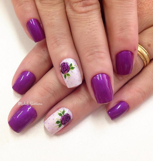 A rather simple but striking Purple nail art design. If you want to be subtle but glamorous at the same time putting a little hint of purple floral designs on your nails can make it stand out.