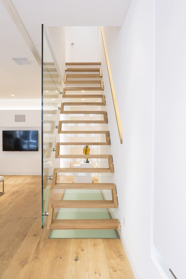 This staircase at Morton Mews is constructed entirely from timber and is fixed to appear as though it is floating.