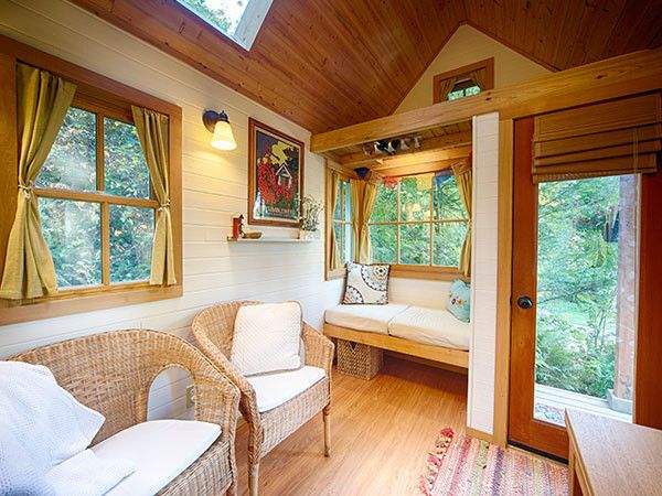 """<a href=""""http://www.tumbleweedhouses.com/collections/customer-slideshows/products/brittanys-fencl"""">Brittany's Tiny House RV</a> showcases the high ceilings in her space."""