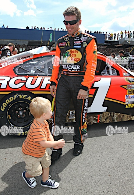 19 August 2012---Jamie McMurray and son, Carter Scott, during the Pure Michigan 400 at the Michigan International Speedway in Brooklyn, MI. His son is so cute!