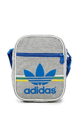 Компактная сумка от Adidas Originals. Аксессуар серого цвета выполнен из текстиля. Детали: внешний и внутренний карманы, широкий регулируемый ремень, фактурный принт в виде логотипа бренда. http://j.mp/1pg1pMq