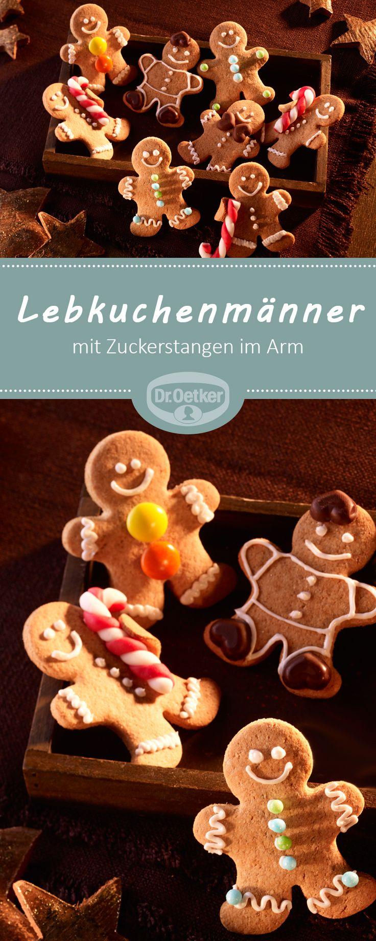 Lebkuchenmänner: Niedliche Lebkuchenmänner mit Zuckerstangen im Arm