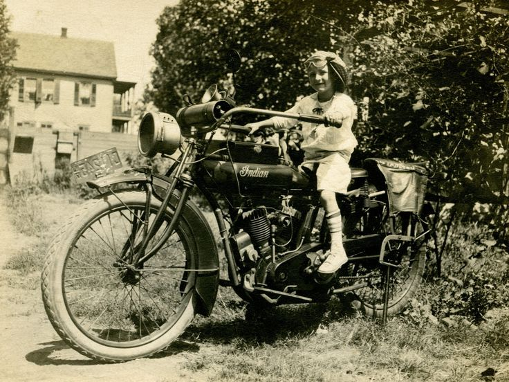 Little girl sitting on an Indian Motorcycle with 1917 New Jersey plates.