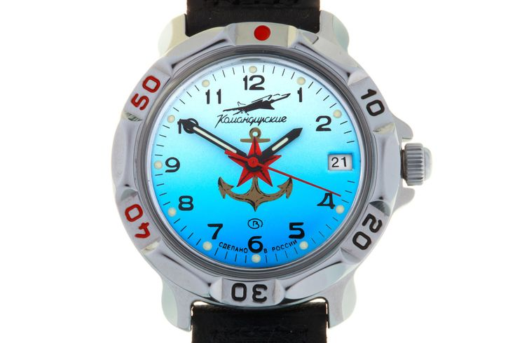 WATCH VOSTOK KOMANDIRSKIE 811084 SOVIET NAVAL AVIATION. In the central part of the watch face there is the emblem of the USSR Navy – a golden Admiralty anchor and a red five-pointed star on top of the anchor shaft. At the top, at the twelve-hour point, is a stylized image (silhouette) of the Naval Air plane TU-22M. #russian #mechanical #military #watches #vostok #komandirskie #gifts #souvenirs #airforce #aircraft #anchor #star