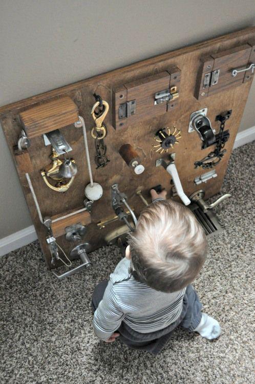 Sensory and motor skills homemade DIY wood board with locks, pulleys, etc