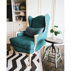 Maybe this West Elm rug with the teal chairs?