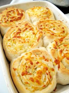 Garlic Cheese Bread Rolls - pizza crust, garlic butter spread, motzarella cheese. Roll like a cinnamon roll and slice, bake at 400 degrees until golden brown! Serve with soup.