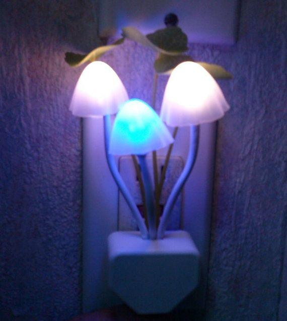 This vibrant color changing mushroom night light is the perfect compliment to any room. Available with US or EU wall plugs. The light appears quite natural and creates a stunning effect like no other. An eye catching accent that will brighten any home and any heart. Controlled by an automatic On/Off light sensor - as soon as the lights go out these little mushrooms spring into action glowing brightly and changing colors. They are also quite bendable so you can position them in any way youd…