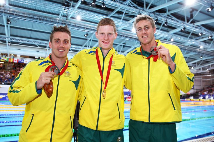 Gold medallist Rowan Crothers (C) of Australia poses with silver medallist Matthew Cowdrey (L) of Australia and bronze medallist Brenden Hall of Australia
