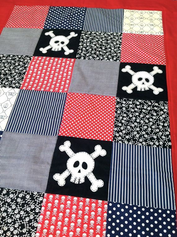 Add a finishing touch to a pirate themed nursery with a skull and crossbones patterned quilt. | via AlphabetMonkey