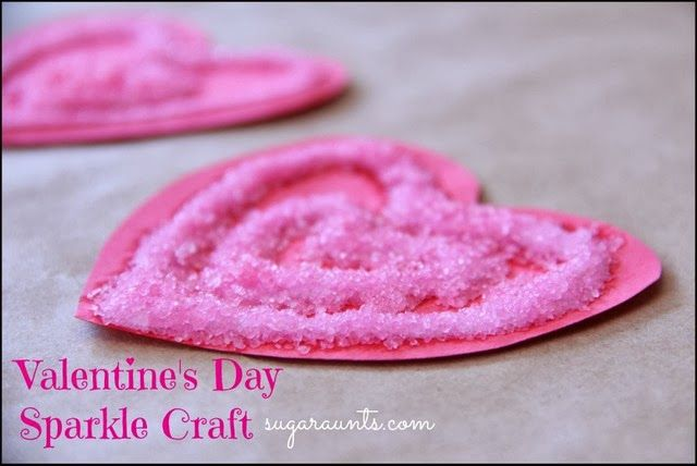 Sparkle heart craft for kids. This is great fine motor and sensory play for Valentine's Day! By Sugar Aunts.