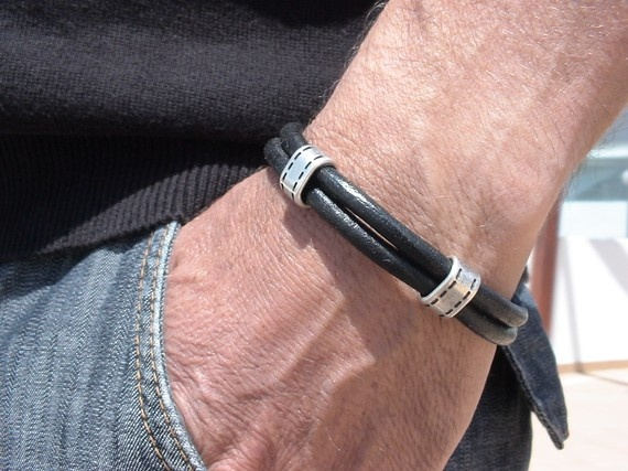 men black leather bracelet with silver plated spacer $32
