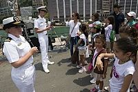 170501-N-ZW825-117   HONG KONG (May 1, 2017) Lt. j.g. Alexis Trelka, left, and Lt. j.g. Kevin Spillane, listen to questions from a tour group visiting the Arleigh Burke-class guided missile destroyer USS Sterett (DDG 104) during the ship's port visit to Hong Kong. Sterett is part of the Sterett-Dewey Surface Action Group operating under the command and control construct called 3rd Fleet Forward. (U.S. Navy photo by Mass Communication Specialist 1st Class Byron C. Linder/Released)