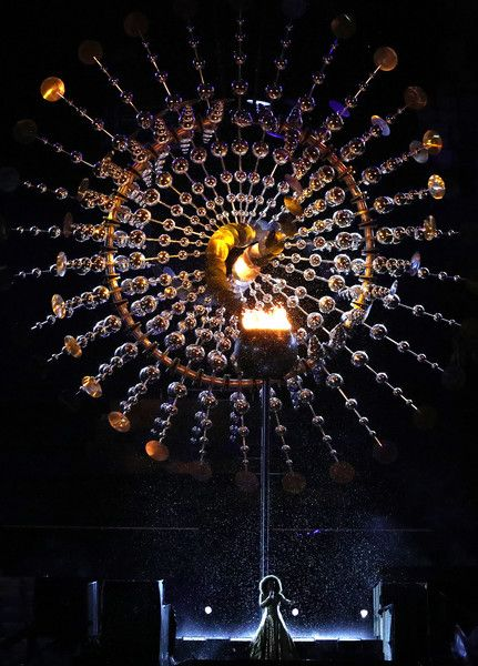 Singer Mariene de Castro performs in front of the Olympic Cauldron while the Olympic flame is being extinguished during the Closing Ceremony on Day 16 of the Rio 2016 Olympic Games at Maracana Stadium on August 21, 2016 in Rio de Janeiro, Brazil.