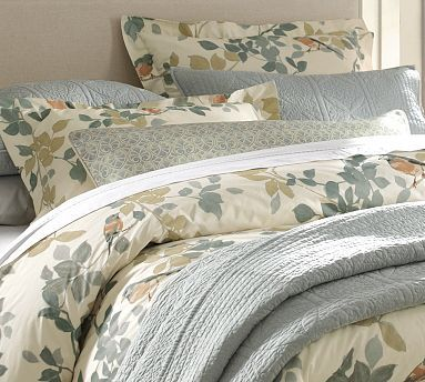 Print duvet cover and shams.  Paired with sold textured shams/throw, colored sheets and additional print throw pillow. Pottery Barn