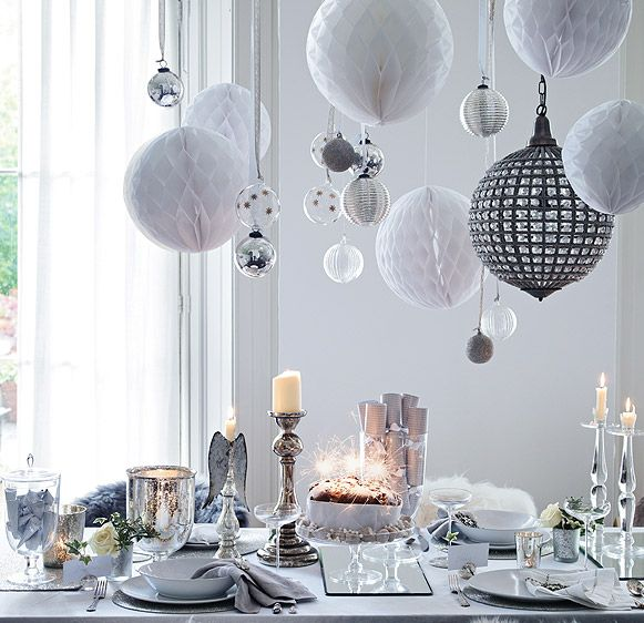 Christmas dining from The White Company's Christmas Look Book (thewhitecompany.com). Like these simple honeycomb paper balls.